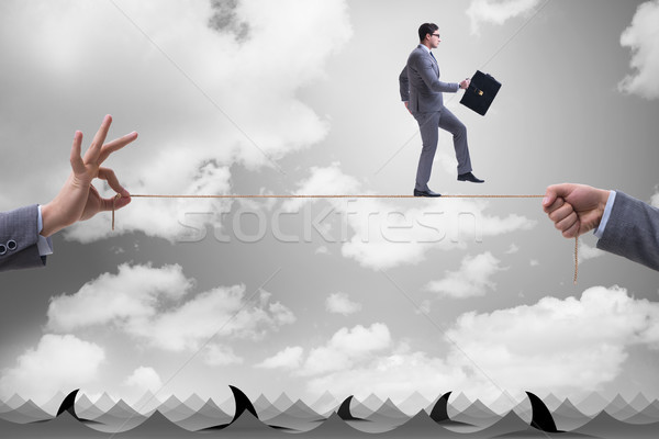 Empresário caminhada apertado negócio fundo corrida Foto stock © Elnur