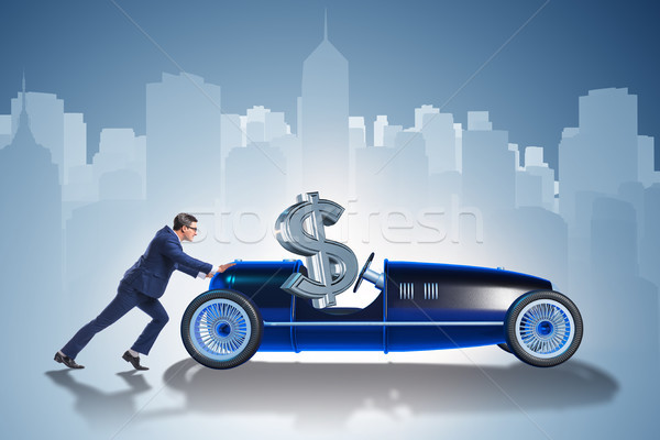 Zakenman voortvarend auto dollar rijden zitting Stockfoto © Elnur