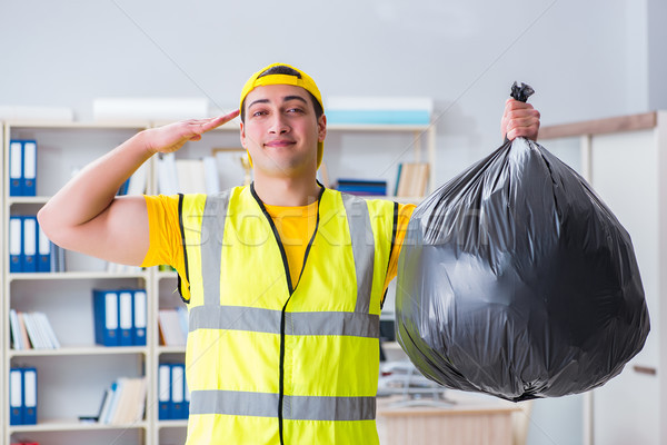 The man cleaning the office and holding garbage bag Stock photo © Elnur