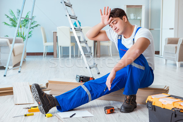 Repairman laying laminate flooring at home Stock photo © Elnur
