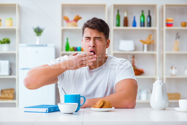 Man falling asleep during his breakfast after overtime work Stock photo © Elnur