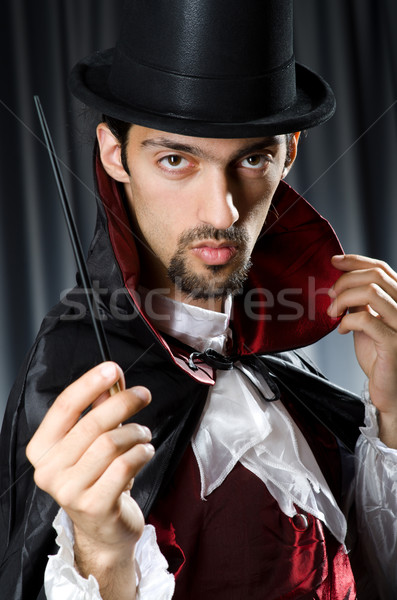 Magician in the dark room with wand Stock photo © Elnur