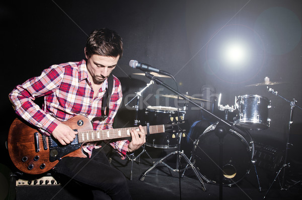Man playing guitar during concert Stock photo © Elnur
