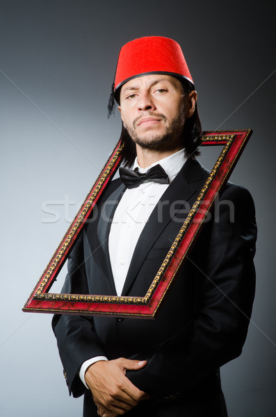Man with fez  hat and picture frame Stock photo © Elnur