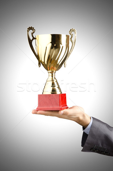 Man being awarded with golden cup Stock photo © Elnur