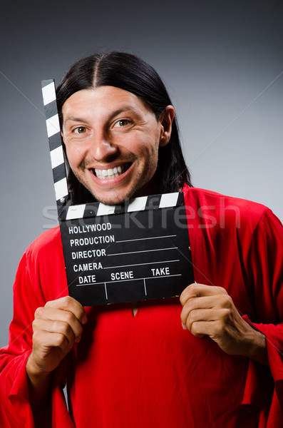 Man in red dress with movie clapboard Stock photo © Elnur