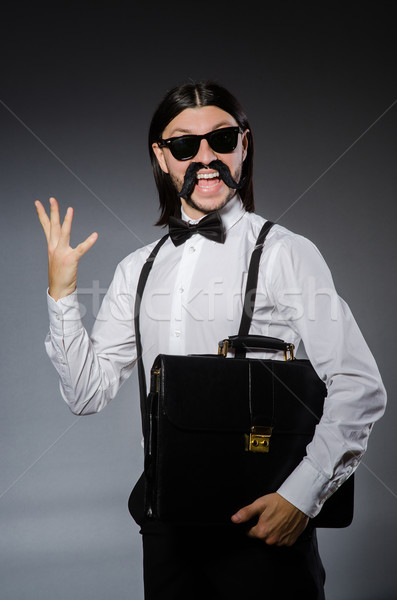 Hombre bigote gafas de sol gris fondo bolsa Foto stock © Elnur