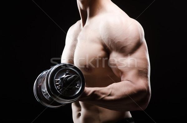 Muskularny kulturysta hantle ciało fitness zdrowia Zdjęcia stock © Elnur