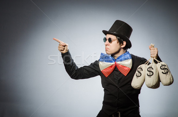 Funny man with money dollar sacks Stock photo © Elnur