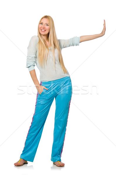 Jeune femme bleu formation pants isolé Photo stock © Elnur