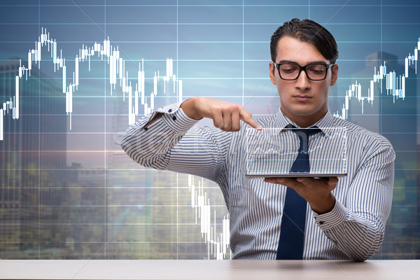 Young businessman in online trading concept Stock photo © Elnur