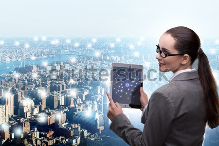 Businesswoman with tablet in global business concept Stock photo © Elnur