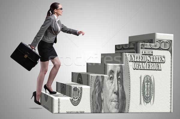 Mujer de negocios escalada dólar escalera dinero ejecutivo Foto stock © Elnur