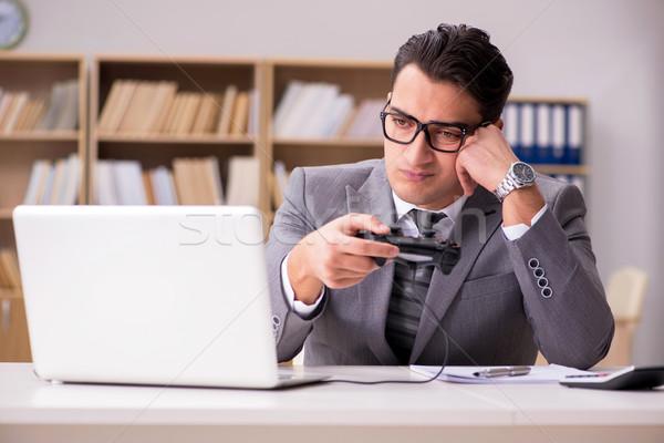 üzletember játszik számítógép játékok munka iroda Stock fotó © Elnur