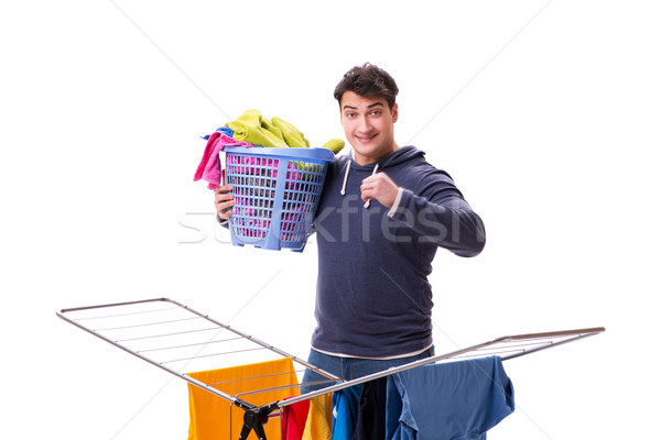 The husband man doing laundry isolated on white Stock photo © Elnur
