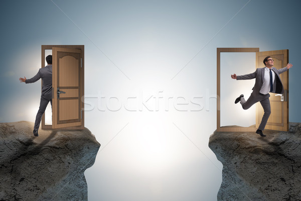 Businessman in teleportation concept with doors Stock photo © Elnur