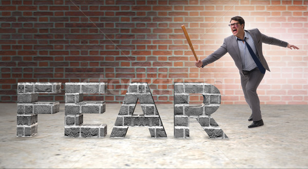 Angry man with baseball bat hitting fear word Stock photo © Elnur