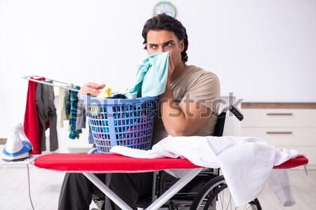 Sad woman ironing clothing at home Stock photo © Elnur