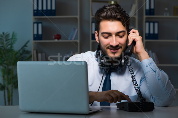 Young man in call center concept working late overtime in office Stock photo © Elnur