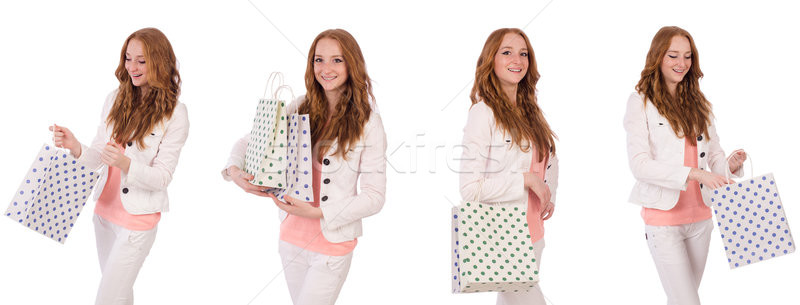 Young woman with shopping bags isolated on white Stock photo © Elnur