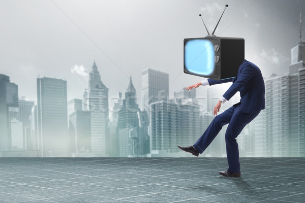 Media zombie concept with man and tv set instead of head Stock photo © Elnur