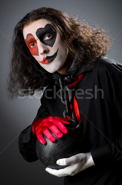 Clown with shackles in studio Stock photo © Elnur