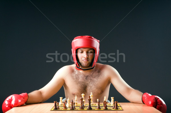 Stock photo: Boxer stuggling with chess game