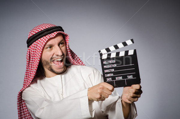Arab with movie clapper board Stock photo © Elnur