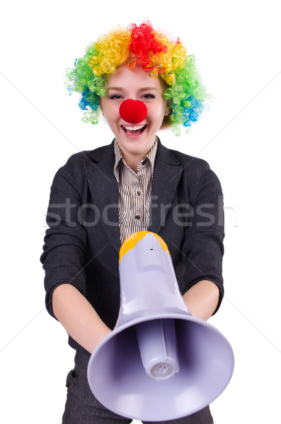 Businesswoman clown with loudspeaker isolated on white Stock photo © Elnur