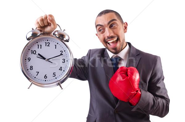 Angry businessman hitting clock isolated on white Stock photo © Elnur