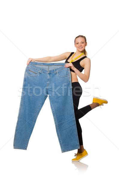 Jeune femme régime heureux fitness exercice jeans Photo stock © Elnur