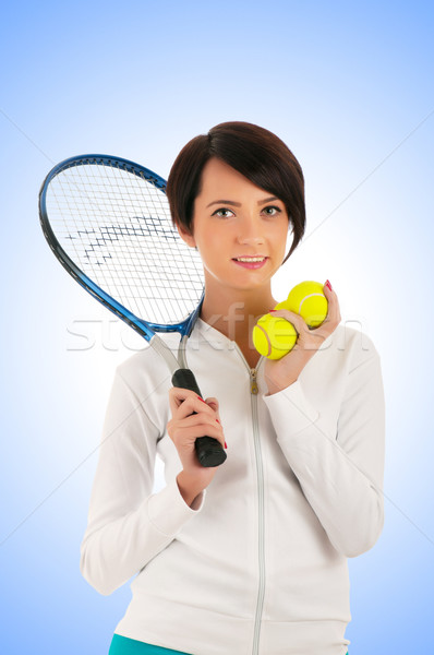 Stock photo: Young girl with tennis racket and bal isolated on white