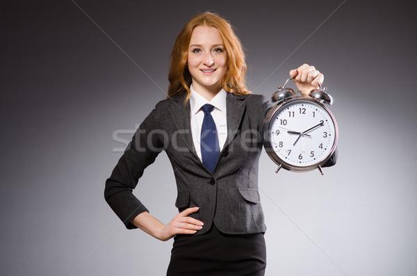 Zakenvrouw klok laat vrouw werk zakenman Stockfoto © Elnur