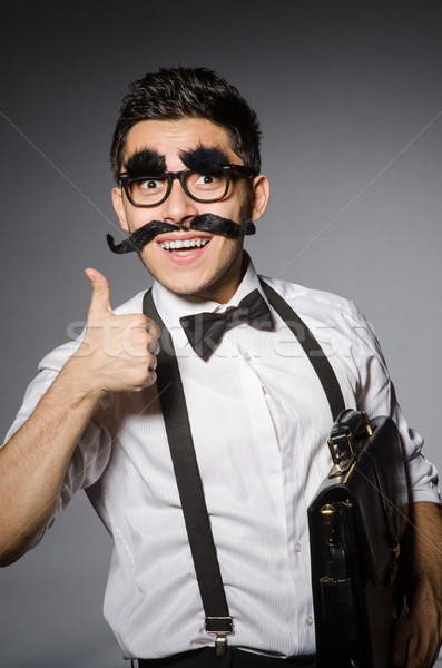 Stock photo: Young caucasian man with false moustache against gray