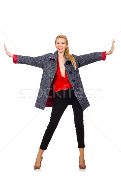 Pretty model in gray coat isolated on white Stock photo © Elnur