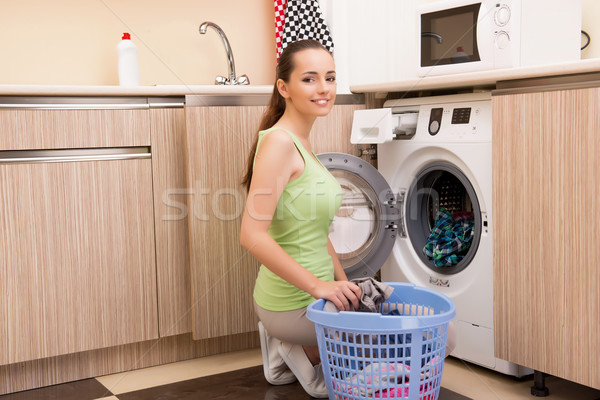 Kadın çamaşırhane ev gülümseme mutlu üzücü Stok fotoğraf © Elnur