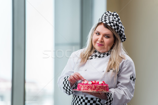 Young woman chef preparing dessert cak Stock photo © Elnur