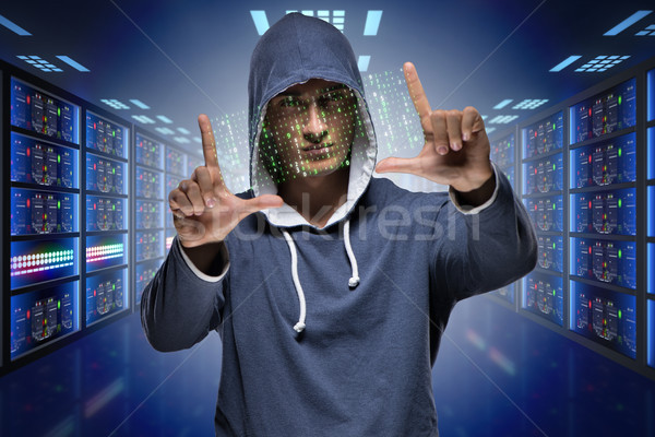 The hacker hacking corporate computer system Stock photo © Elnur