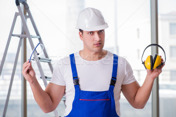 Stock photo: The young worker with noise cancelling headphones