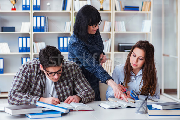 Young student and teacher during tutoring lesson Stock photo © Elnur