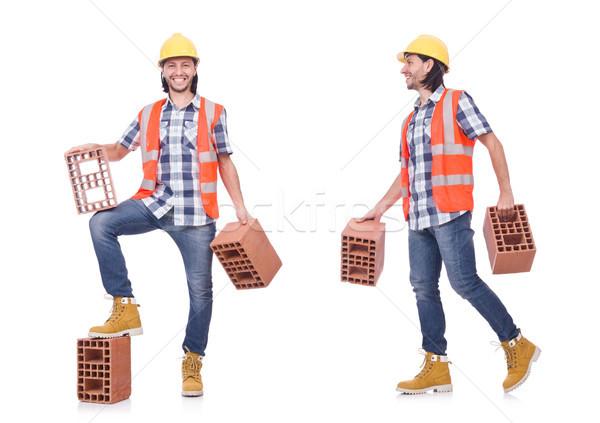 Construtor argila tijolos isolado branco homem Foto stock © Elnur