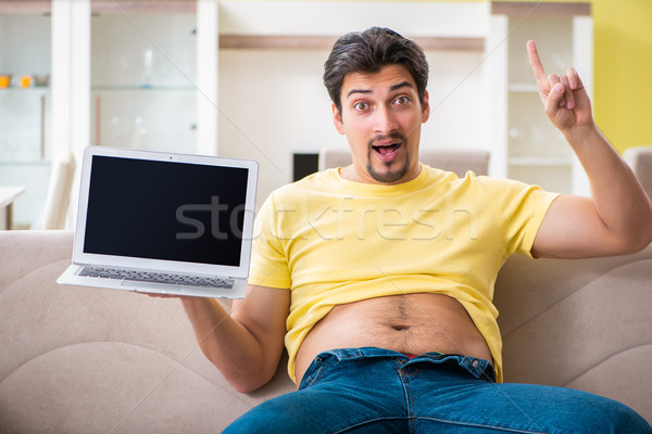 Man suffering from extra kilos in dieting concept  Stock photo © Elnur