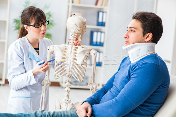 Doctor is explaining to patient with neck injury Stock photo © Elnur