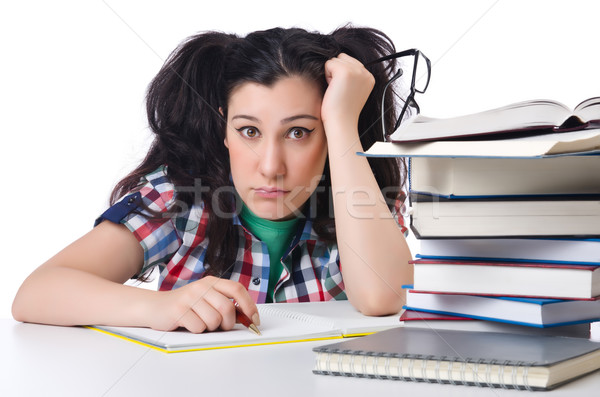 Tired student with textbooks on white Stock photo © Elnur