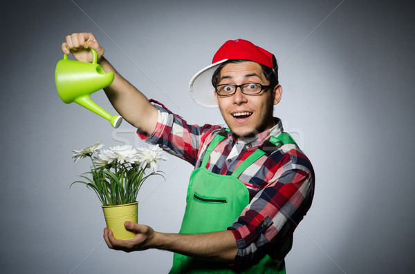 Funny man with watering can Stock photo © Elnur