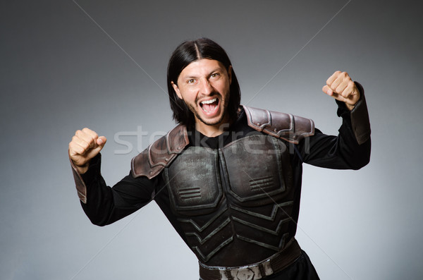 Colère guerrier sombre homme costume amusement Photo stock © Elnur
