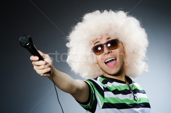 Stock photo: Funny man with afro hairstyle isolated on white