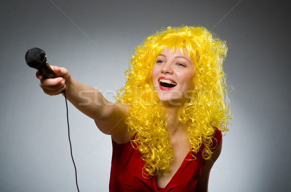 Young woman with mic in music concept Stock photo © Elnur