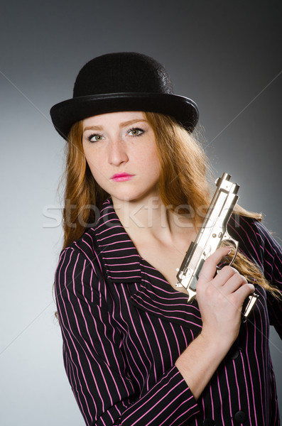 Foto d'archivio: Donna · gangster · gun · vintage · sexy · modello
