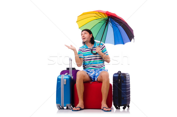 Traveler with cases and umbrella isolated on white Stock photo © Elnur